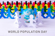 Leinwanddruck Bild Circle of paper people holding hands around the globe made of paper cut . World Population Day.