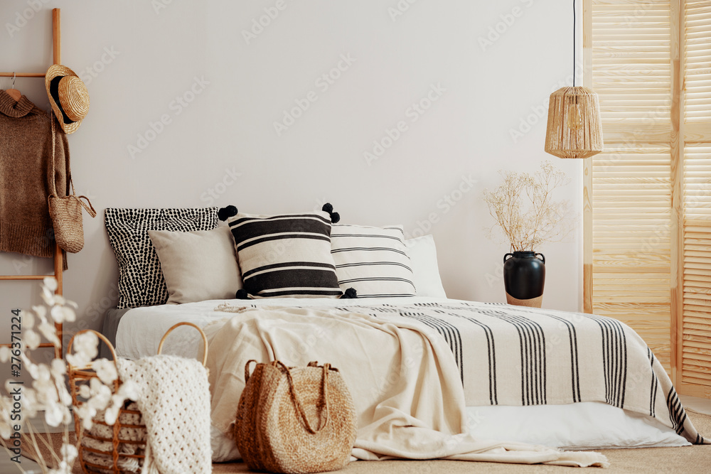 Fototapety, obrazy: Stripped bedding on white king size bed, copy space on empty wall