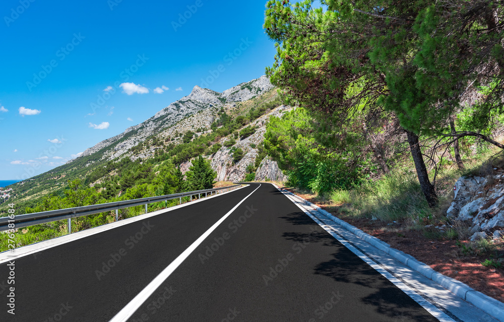 Fototapety, obrazy: Mountain road on a summer sunny day.