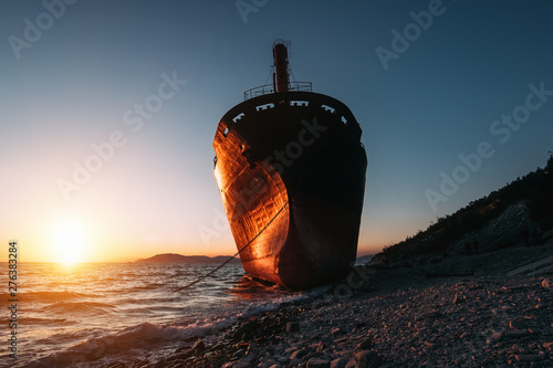 Cargo ship run aground on sea side after storm Canvas Print