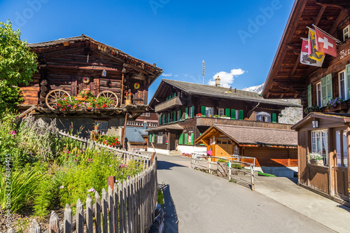 Foto auf Leinwand Lachs Traditional wodden house in Murren, a traditional Walser mountain village in the Bernese Highlands of Switzerland.