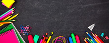 School Supplies Corner Border Banner. Overhead View On A Chalkboard Background With Copy Space. Back To School Concept.