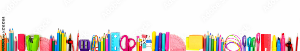 Fototapeta School supplies long bottom border. Top view isolated on a white background. Back to school concept.