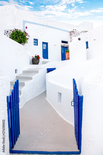 Fototapety, obrazy: Classic white Greek architecture with blue doors and shutters, Santorini, Greece, Aegean sea, Europe. Travel concept, details of the one of the most beautiful travel destinations of the world