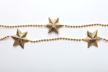 Gold Star And Bead Garland On White Backgroun. Flat Lay.  Top View.
