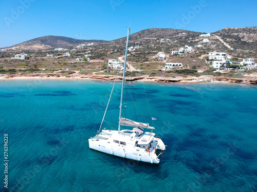 Catamaran sailing in  blue, turquoise water in Greece, beautiful catamaran next Fotobehang