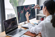 Business Team Investment Working With Computer, Planning And Analyzing Graph Stock Market Trading With Stock Chart Data, Business Financial Investment And Technology Concept
