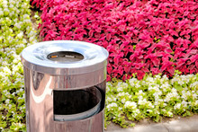 Trash Can With Cigarette In Ashtray At Outdoor Street Smoking Area Against Red White Green Flowers Background Closeup View Of Metal Bin For Garbage Collecting