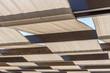 canvas print picture - Große Terrassenüberdachung mit Stoffbahnen und Holzbalken als Sonnenschutz