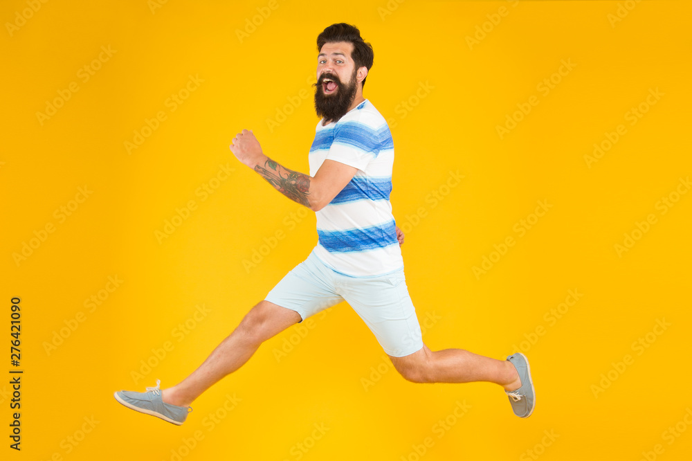Fototapety, obrazy: Hurry up. Summer vacation. Man bearded hipster with mustache long beard running yellow background. Guy dressed striped shirt on summer vacation. Barbershop concept. Summer style. Sale and discount