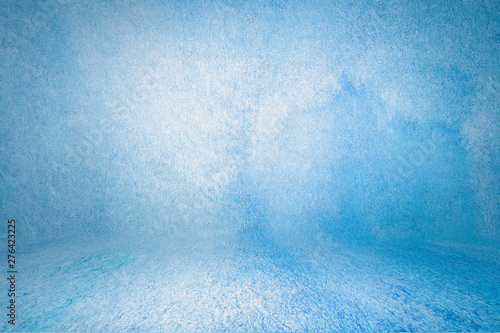 Photo blue photo backdrop wall and floor lit by lamps, studio background for photos