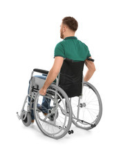 Handsome Young Man In Wheelchair Isolated On White