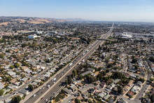 Aerial View Of Streets, Buildings And Traffic Along The 880 Freeway Near Hayward, San Leandro And Oakland, California.