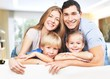 canvas print picture - Young  family at home smiling at camera