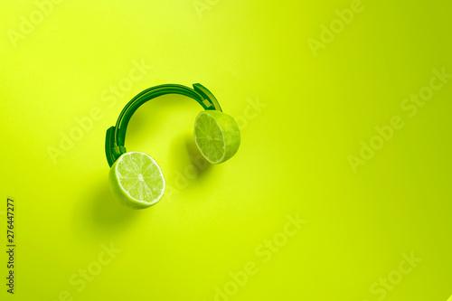 Foto  Green citrus headphones. Creative concept for summer parties.