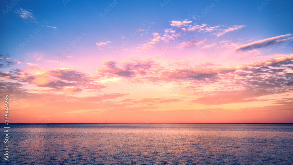 Fototapeta Beautiful sunset over Lake Superior with a sail boat