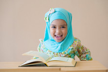 Happy Muslim Kid During Quran During Ramadan Month.