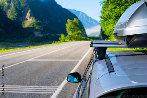 Obraz na plátně  Picturesque mountains and the canyon of the Caucasus and the car with a roof rac