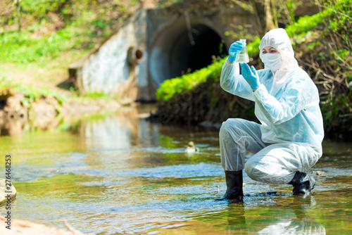 Valokuva  hazardous contaminated sewage water, environmentalist job