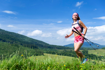 Girl run on the trail in the mountains.