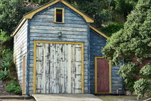 Historic Wooden Boat Shed With Paint Peeling Off Weathered Walls.