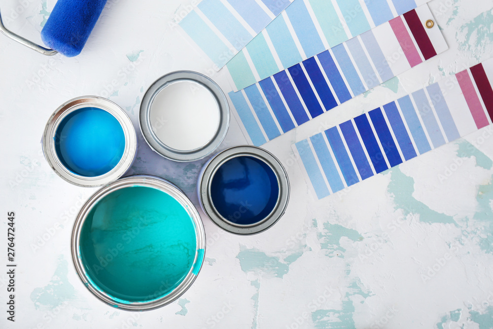 Fototapeta Cans of paint with palette samples on light background