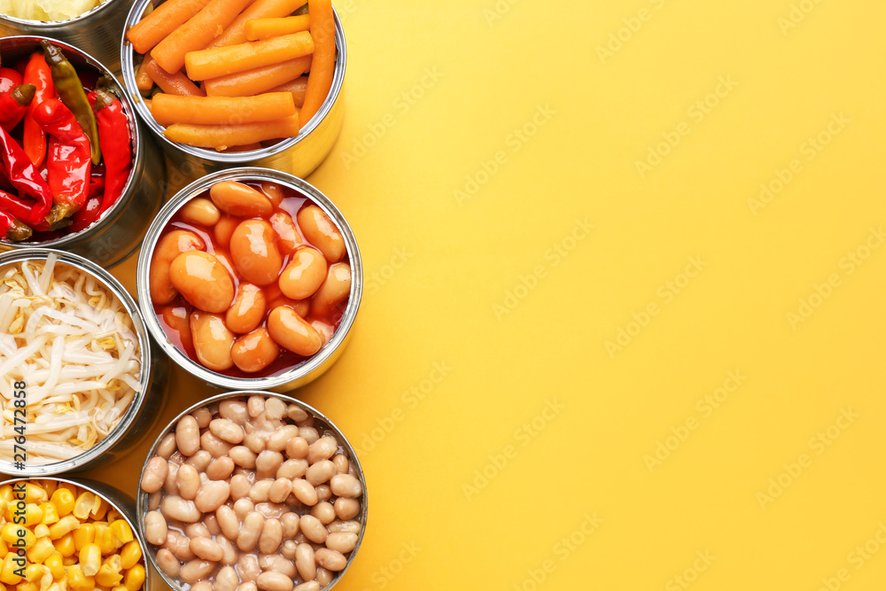 Fototapety, obrazy: Tin cans with different food on color background