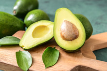 Fresh Ripe Avocados On Wooden Boards