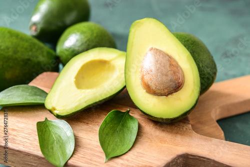 Stampa su Tela Fresh ripe avocados on wooden boards