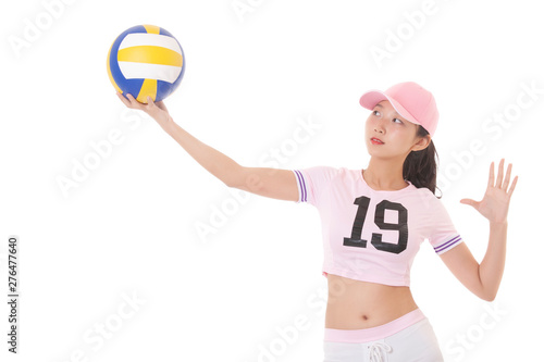 Portrait of a Asian teenage momen holding a volleyball