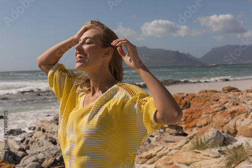 Woman smiling at beach on a sunny day