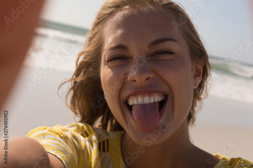 Woman having fun at beach on a sunny day