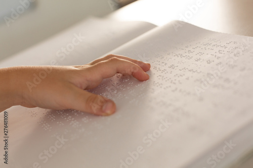 Fototapety, obrazy: Blind boy hand reading a braille book in classroom