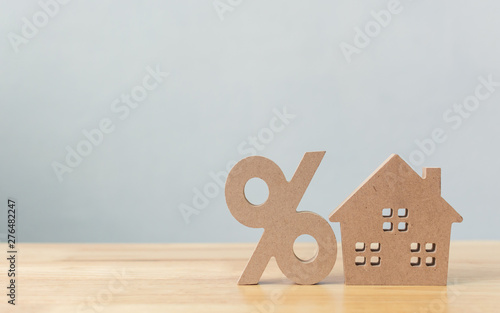 Canvas Prints Countryside Percentage and house sign symbol icon wooden on wood table with white background
