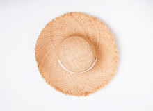 Feminine Straw Hat With Big Fields Isolated On Thite Background