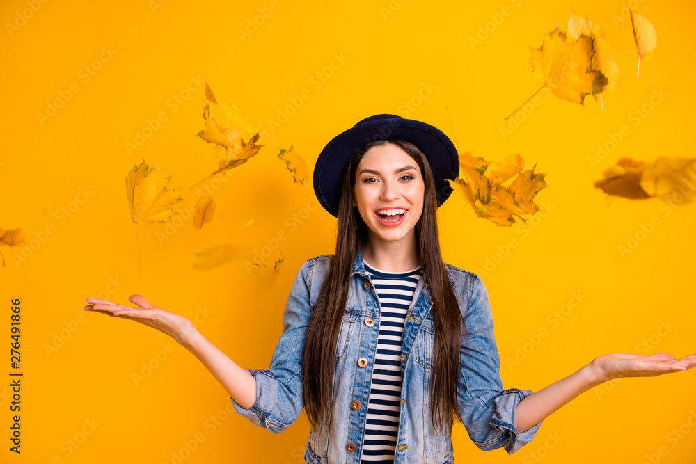 Fototapeta Portrait of her she nice-looking winsome attractive lovely optimistic cheerful cheery straight-haired lady throwing leaves isolated over bright vivid shine yellow background