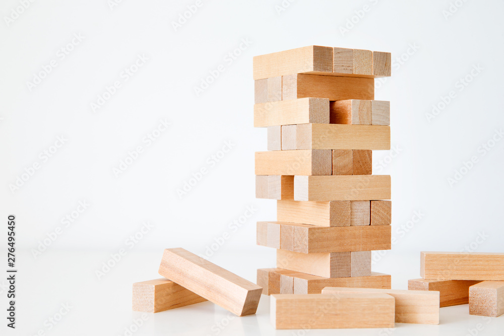 Fototapeta Wooden block tower game isolated on white background