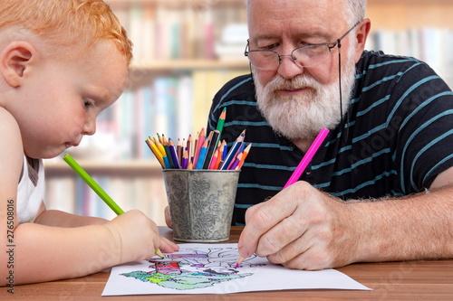 Teamwork between grandfather and grandson to color a drawing Tapéta, Fotótapéta