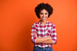 canvas print picture - Portrait of her she nice attractive lovable lovely cheerful cheery content wavy-haired lady wearing checked shirt folded arms isolated on bright vivid shine orange background