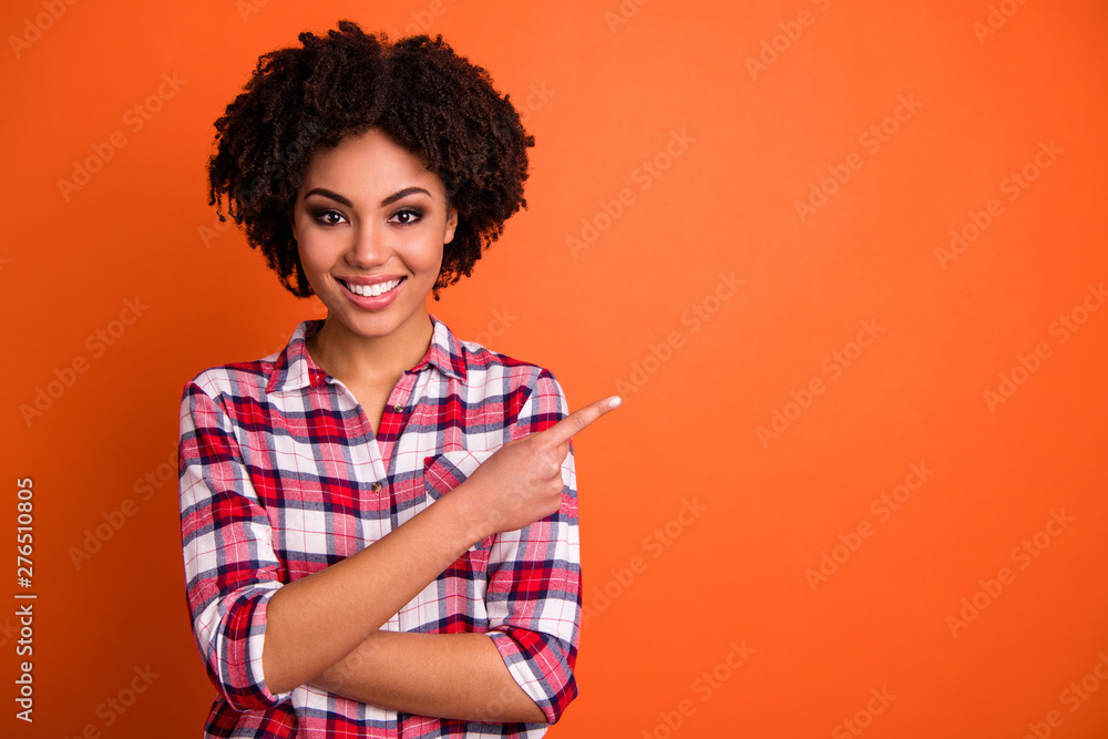 Fototapety, obrazy: Close-up portrait of her she nice attractive cheerful cheery confident wavy-haired lady wearing checked shirt pointing aside tips feedback advert isolated on bright vivid shine orange background