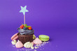 canvas print picture - Beautiful cupcake against saturated dark purple background