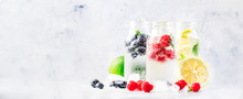 Summer Drinks Set. Berry, Fruit And Citrus Non-alcoholic Refreshing Ice Cold Beverages And Cocktails In Glass Bottles On White Background