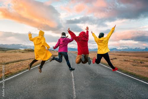 Obraz four friend jump on the road at sunset - fototapety do salonu