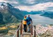 Leinwandbild Motiv happy blue yellow couple tourists
