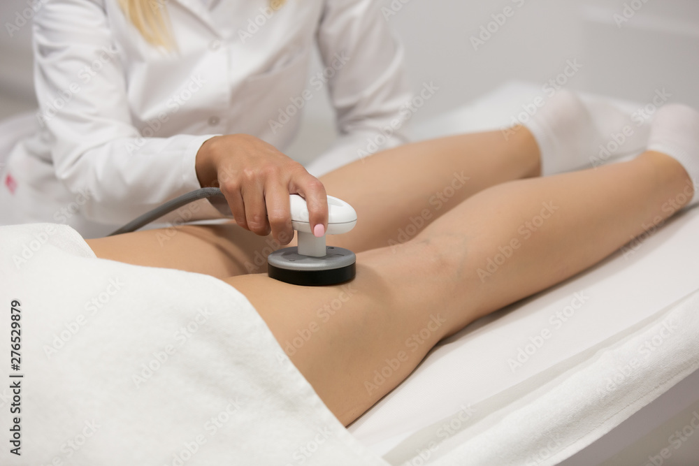 Fototapety, obrazy: Slim woman getting anticellulite and anti fat therapy in beauty salon