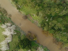 Overhead Shot Of A Muddy River And Surrounding Vegetation