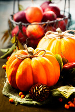 Autumn Still Life With Pumpkins, Apples And Leaves On Old Wooden Background