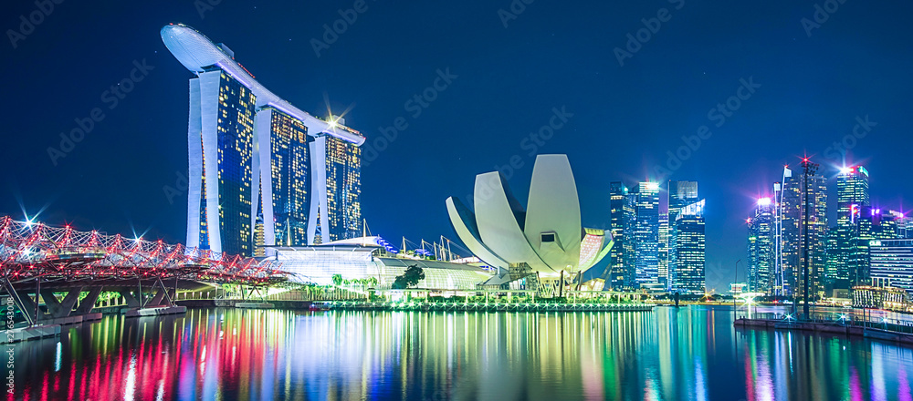 Fototapeta Panorama of Singapore cityscape. beautiful business modern building skyscraper around Marina bay at night. landmark and popular for tourist attractions : Singapore, 9 May 2019