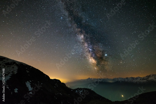 Foto auf Gartenposter Cappuccino Milky way galaxy stars over the Alps, Mars and Jupiter planet, snowcapped mountain range, astro night sky stargazing