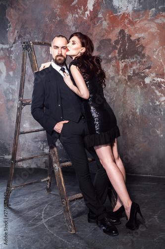 Foto op Aluminium Dance School Beautiful couple, bearded man and red head woman hugging man . Studio shot, isolated on shabby wall. Studio shot, isolated